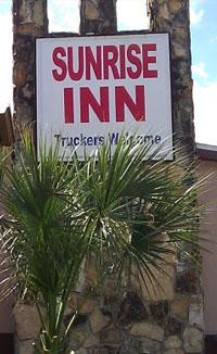 Sunrise Inn Entrance with palms
